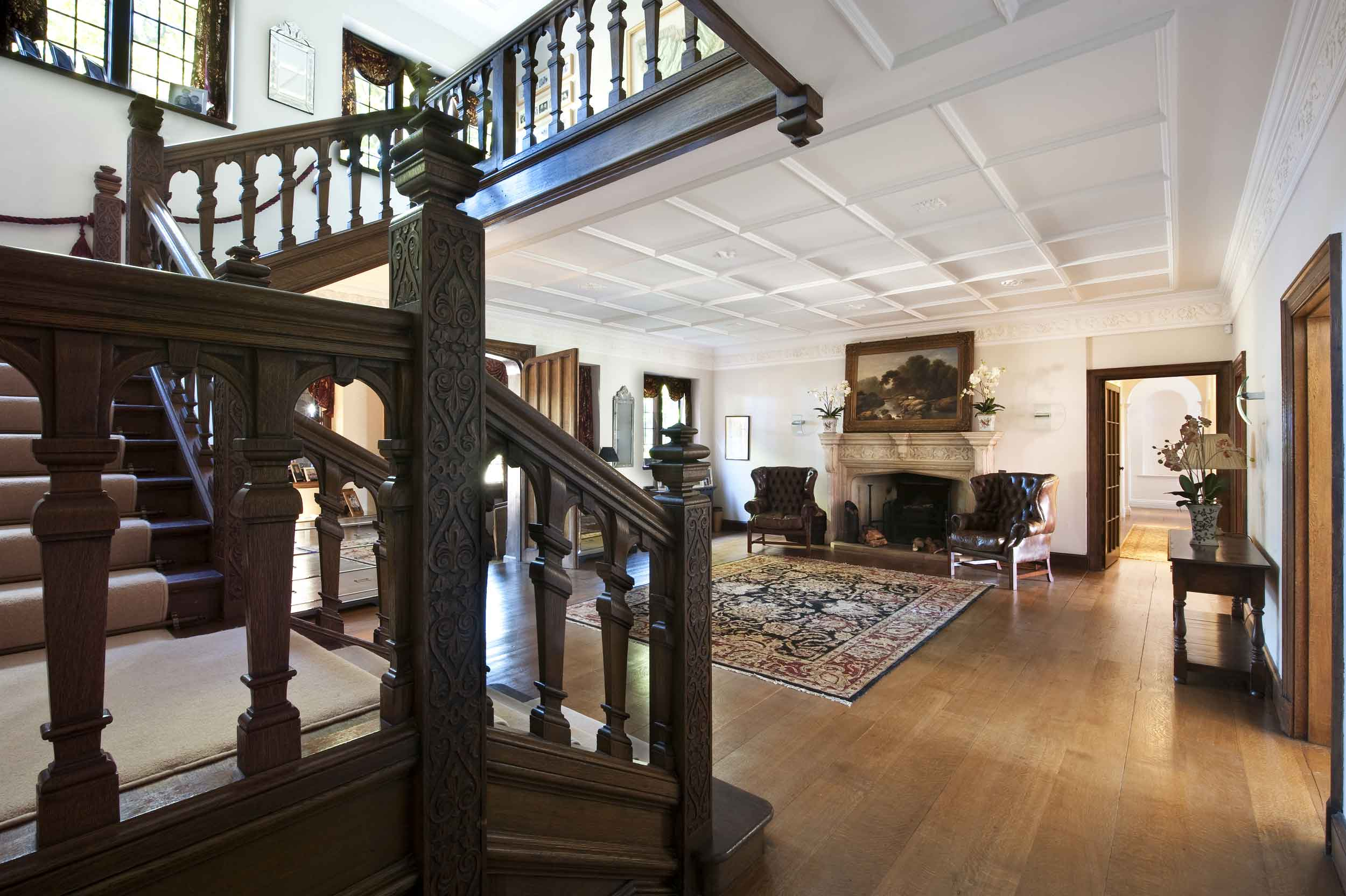 Lock House is a beautiful example of the Vernacular Revival style. The Jacobean-style staircase, which dominates the grand foyer, is among the original turn-of-the-century details.