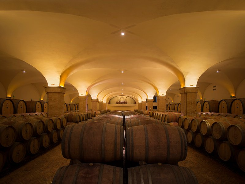 Castiglion del Bosco's cellar, filled with oak barriques, is overlooked by an exclusive tasting room.