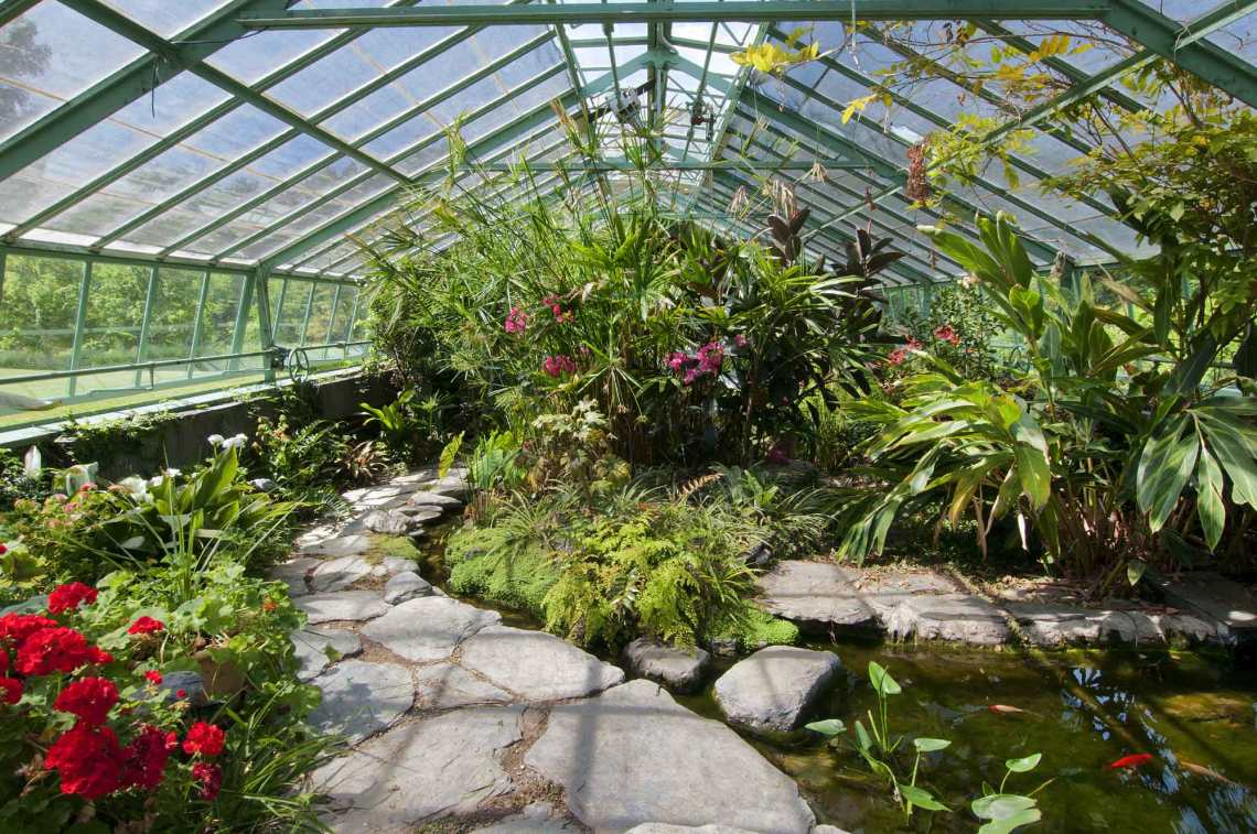6 homes with glorious greenhouses christie s for Koi pond greenhouse