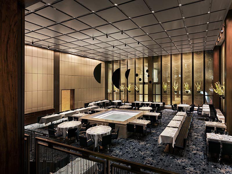 An Alexander Calder mobile hangs above the white marble pool at the center of The Pool restaurant in New York, a hotly anticipated seafood restaurant inside the Seagram building.