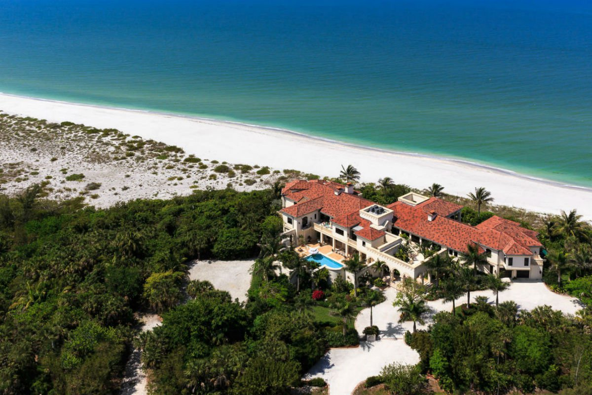 Set on silver sands and turquoise seas like a jewel in a crown, Mandalay lies on an unspoiled barrier island with spectacular sunset vistas of the Gulf of Mexico. The centerpiece of the estate is a 10,960-square-foot Mediterranean-inspired villa surrounded by lush, classically inspired gardens, protected by a seawall, which lead down to a private beach with a boat dock.