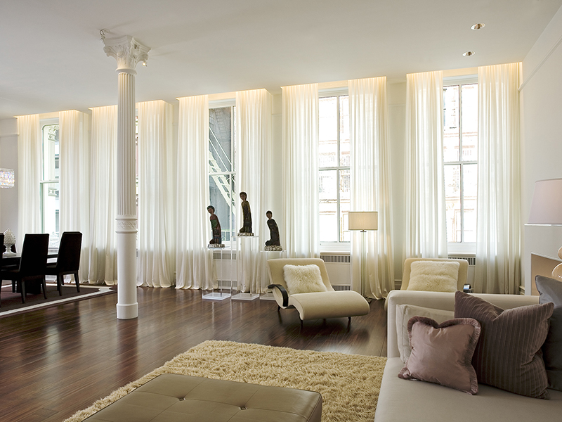 Living and dining room with large windows