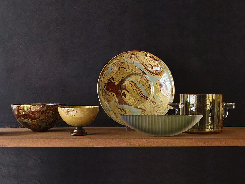 Rebecca Willer patterned dishes on a shelf