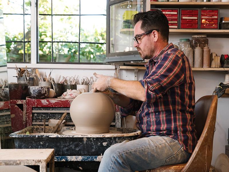 Man working at potter's wheel