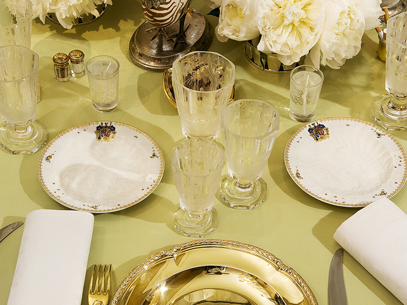 Gold and green-themed table setting by Pinto Interior Design