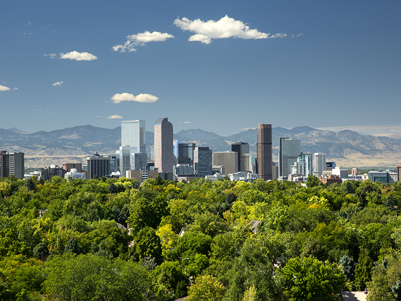 Downtown Denver with views of the Rocky Mountains behind
