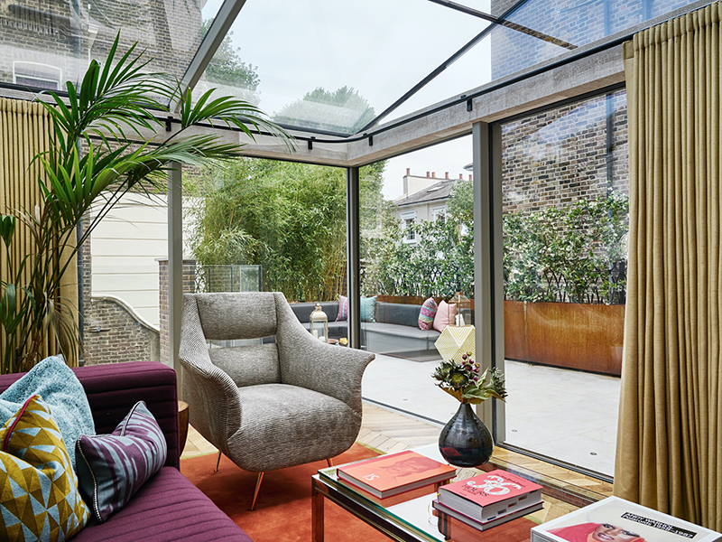 A sitting room, where curtains are used to frame the outdoor view