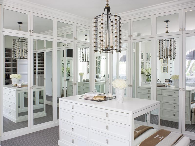 A mirror-filled walk-in closet