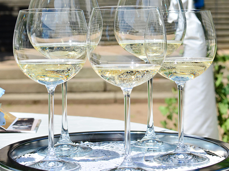 Champagne served in white wine glasses