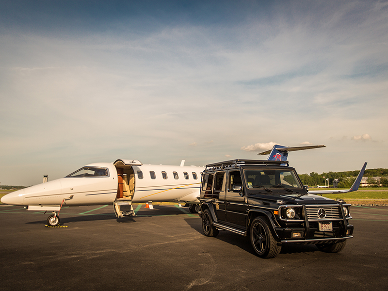 A Magellan private jet with Mercedes parked in front of it