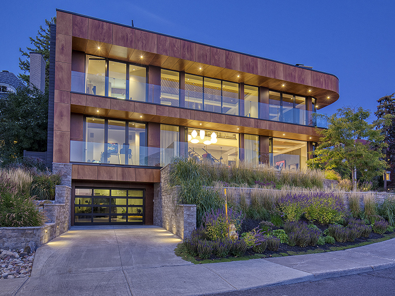 A modern home pictured at night