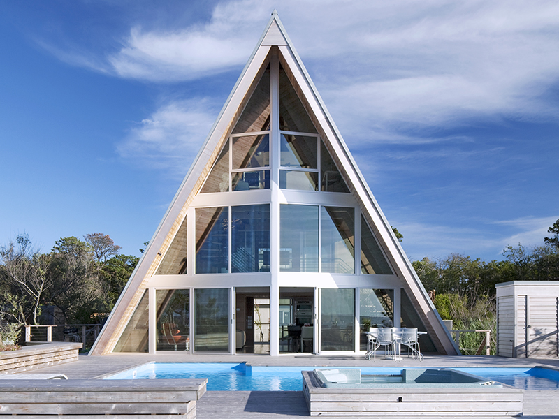 An oceanside A-frame home with pool