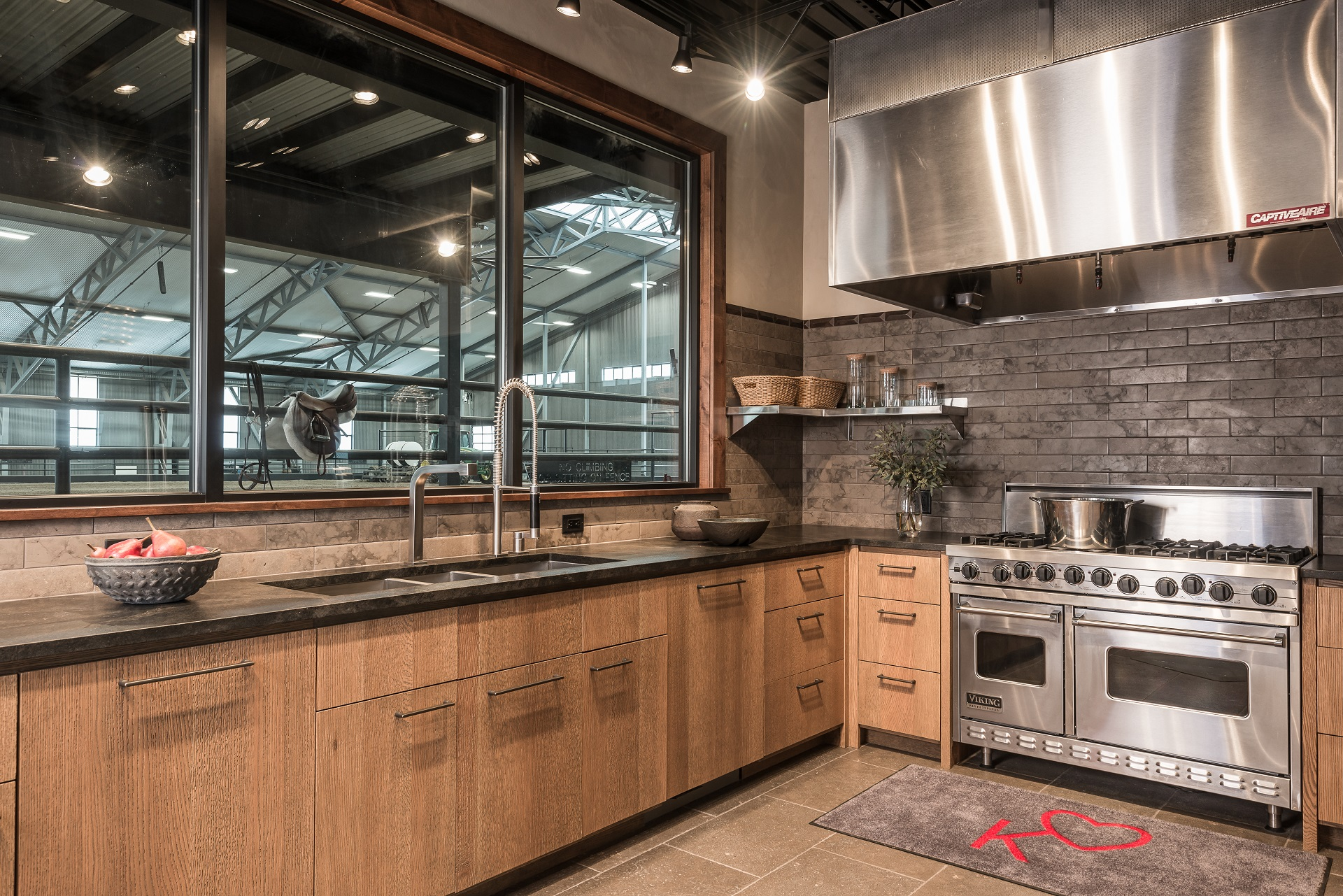 large catering kitchen serves the arena's VIP lounge which also includes a seating area warmed by a fireplace, a large dining room and a private apartment. On the second level is another seating area with a balcony overlooking the outdoor arena.