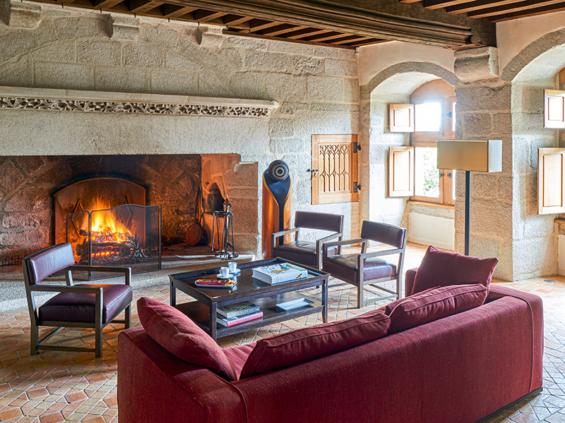 Living room with fireplace at Château du Hénan in brittany, France