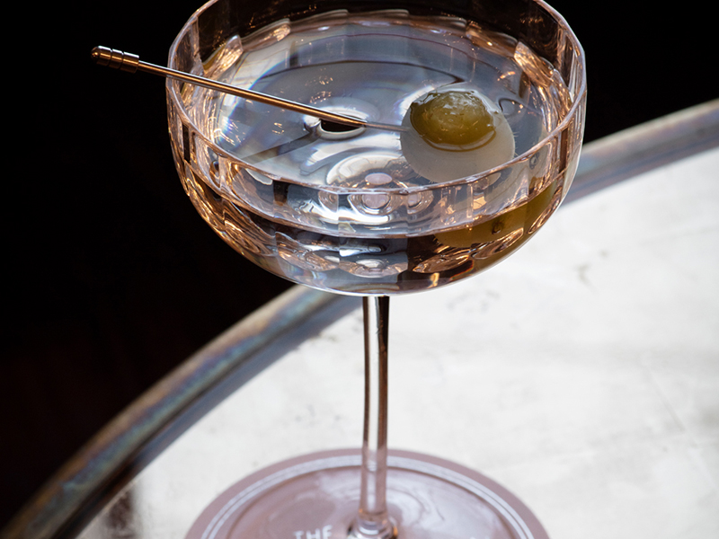 A martini glass with olive