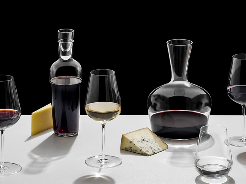 Glassware and wine decanters on a white table