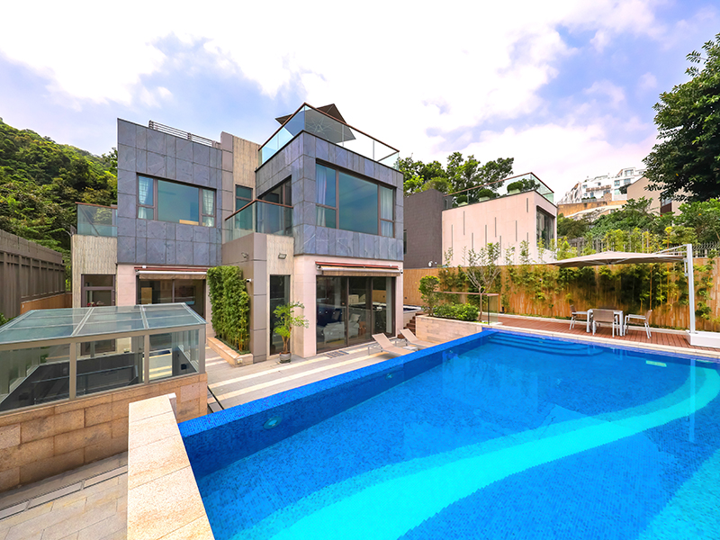 The view over the pool onto a modern house