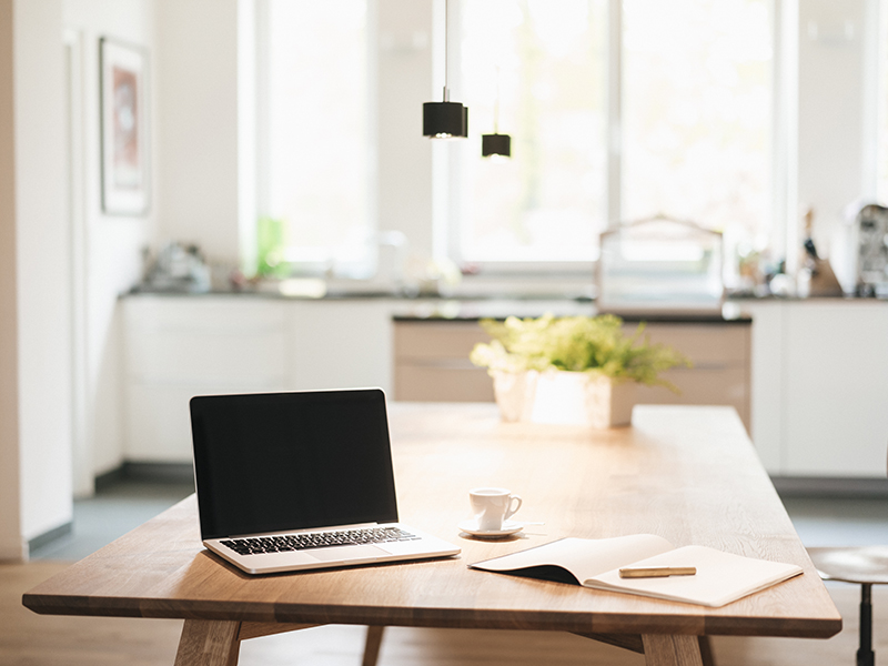 Kitchen table with laptop computer for long term working from home