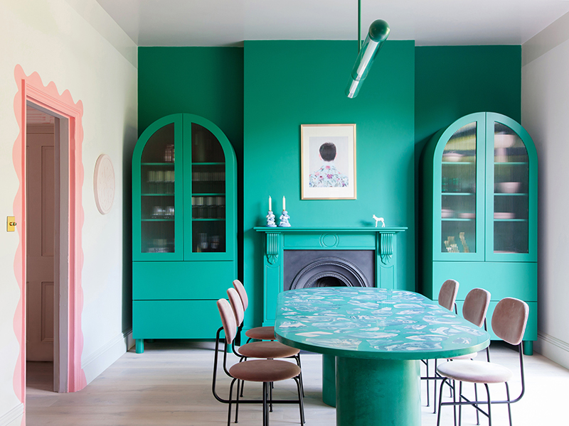 2LG employed color theory to create this teal and pink dining room