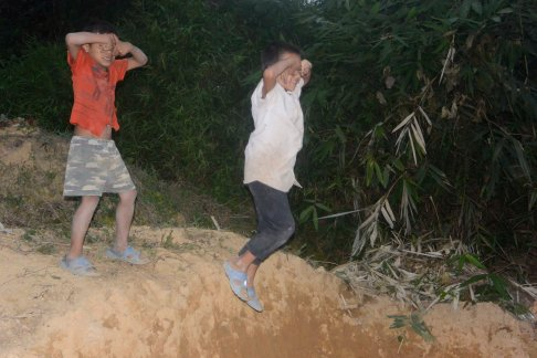 """The kids would shout """"SPIDERMAN!"""" and jump off the dirt mound."""