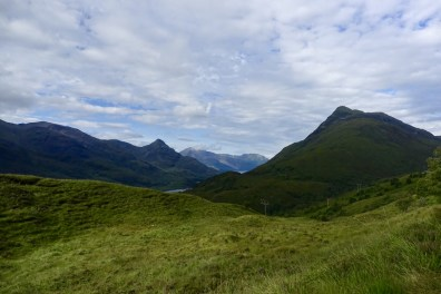 A panorama view of lush green mountains on the West Highland Way