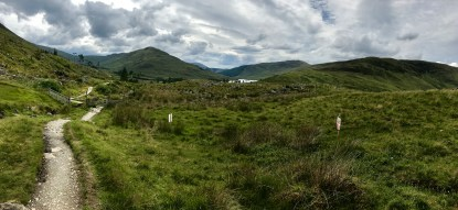 A lush green landscape with some hills in the distance on the West Highland Way