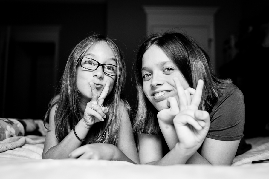 Sisters on the bed, capturing connection, family photography, childhood, teenagers, teenage portraiture, children's portraits,
