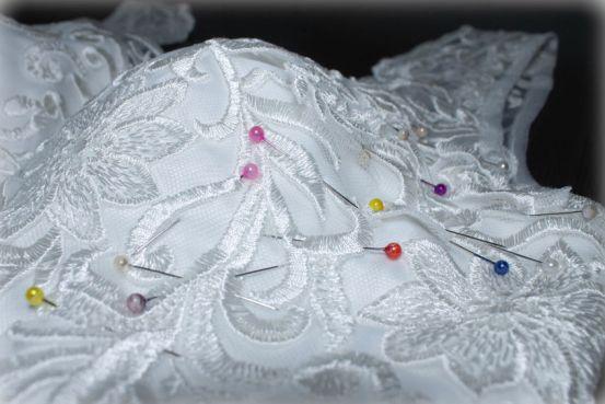 Seamstress-working-on-wedding-dress-alterations.