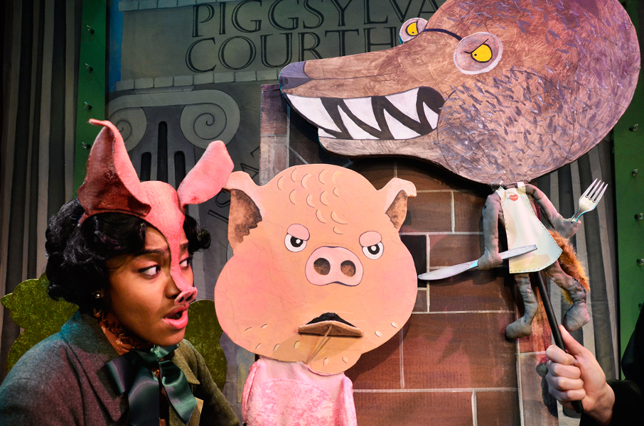 Porcine reporter Magill enacts the story of the Three Little Pigs with puppets. Photo by Suzanne Plunkett