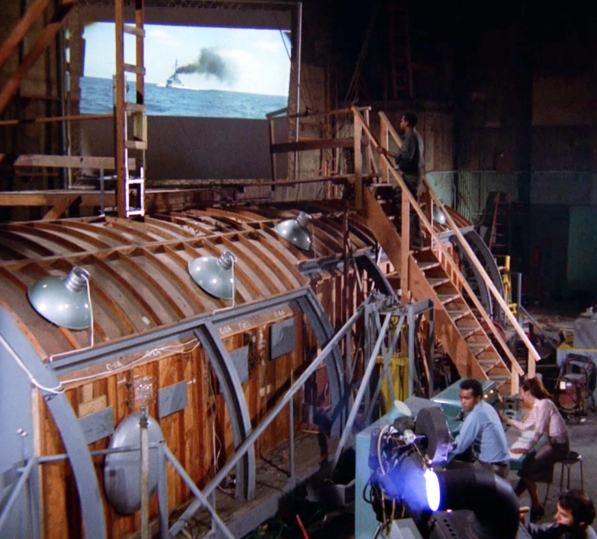 """Barney (Greg Morris) and Tracey (Lee Meriwether) run the control board for the elaborate false journey of """"Submarine"""""""