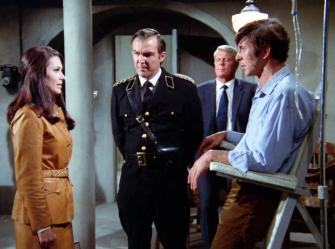 """Colonel Alex Vorda (Anthony Zerbe, center) involves two IMFers (Julie Gregg, Peter Graves) in the interrogation of a third (Leonard Nimoy) in """"The Amnesiac"""""""