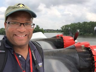 """Christopher C. Odom on location with """"Airborne Unlimited"""" at EAA AirVenture 2016 in Oshkosh, WI on top of the Martin Mars Seaplane"""