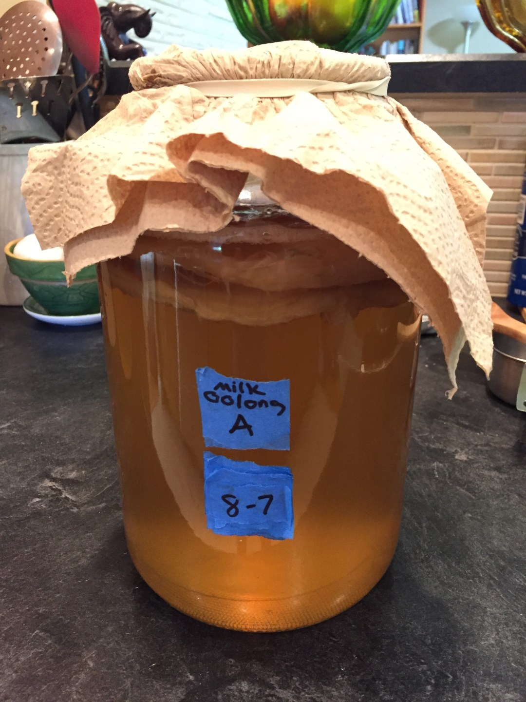 Milk oolong kombucha in one gallon glass jar