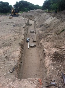 Trenches for grade beams starting waiting for steel reinforcing.