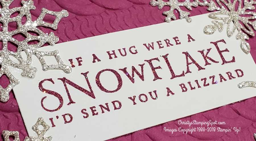 A close up at the Sending a snowflake hug card's sentiment