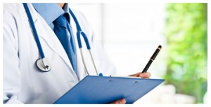 doctor writing on a tablet
