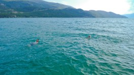 Harrison and Travis floating in the pristine Lake water.