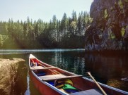 We pulled up the canoe at the far side of the lake where there's a decent size rock where there's room for 4 to hang out, and cliff jumping off to the right.
