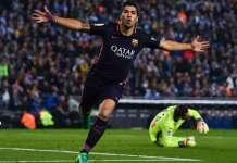 Luis Suarez celebrates his first goal against Espanyol