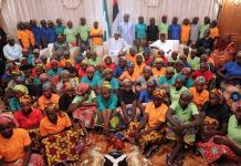 President Muhammadu Buhari with some rescued Chibok girls