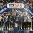 Newcastle players celebrate winning the Championship title