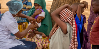 FILE: A nurse vaccinating children against measles.