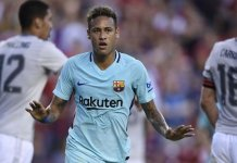 Neymar celebrates scoring for Barcelona in the first half