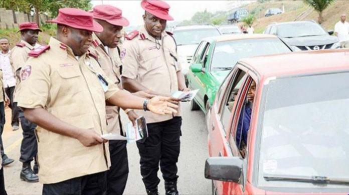 FRSC officials questioning a motorist in Nigeria