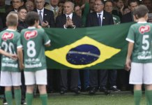 Brazil's President Michel Temer (centre) attends the funeral of the members of the Chapecoense team killed in a plane crash in Colombia