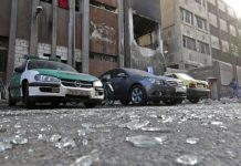 Debris lie on the ground at the site of a double suicide bomb attack which hit the al-Midan police station in Syria's capital Damascus