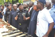 The Commissioner of Police, Edgal Imohimi (middle), receiving the weapons yesterday in Ikorodu