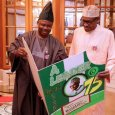 FILE PHOTO: Governor Ibikunle Amosun presenting a birthday card to President Muhammadu Buhari in 2017