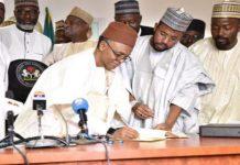 Gov. Nasir El-Rufai signing the budget into law. Photo: NAN