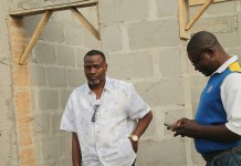 Chairman of Surulere Local Government, Tajudeen Ajide, (L) inspecting the construction of a new Customary Court